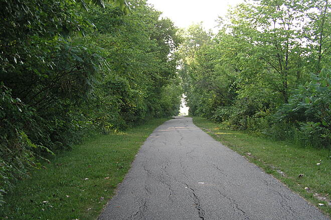 Clinton River Spillway Bike Path The tree-lined trail Along the Clinton River Spillway in Harrison Township, Michigan.