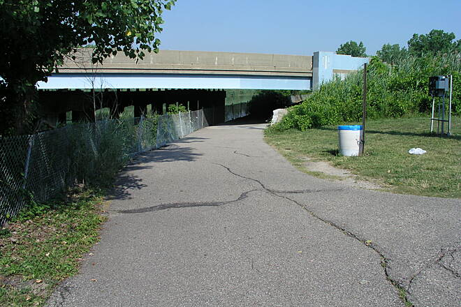 Clinton River Spillway Bike Path Path to Shady Side Park in Mt. Clemens  Under the bridge and down the path with hills and dips to the park.