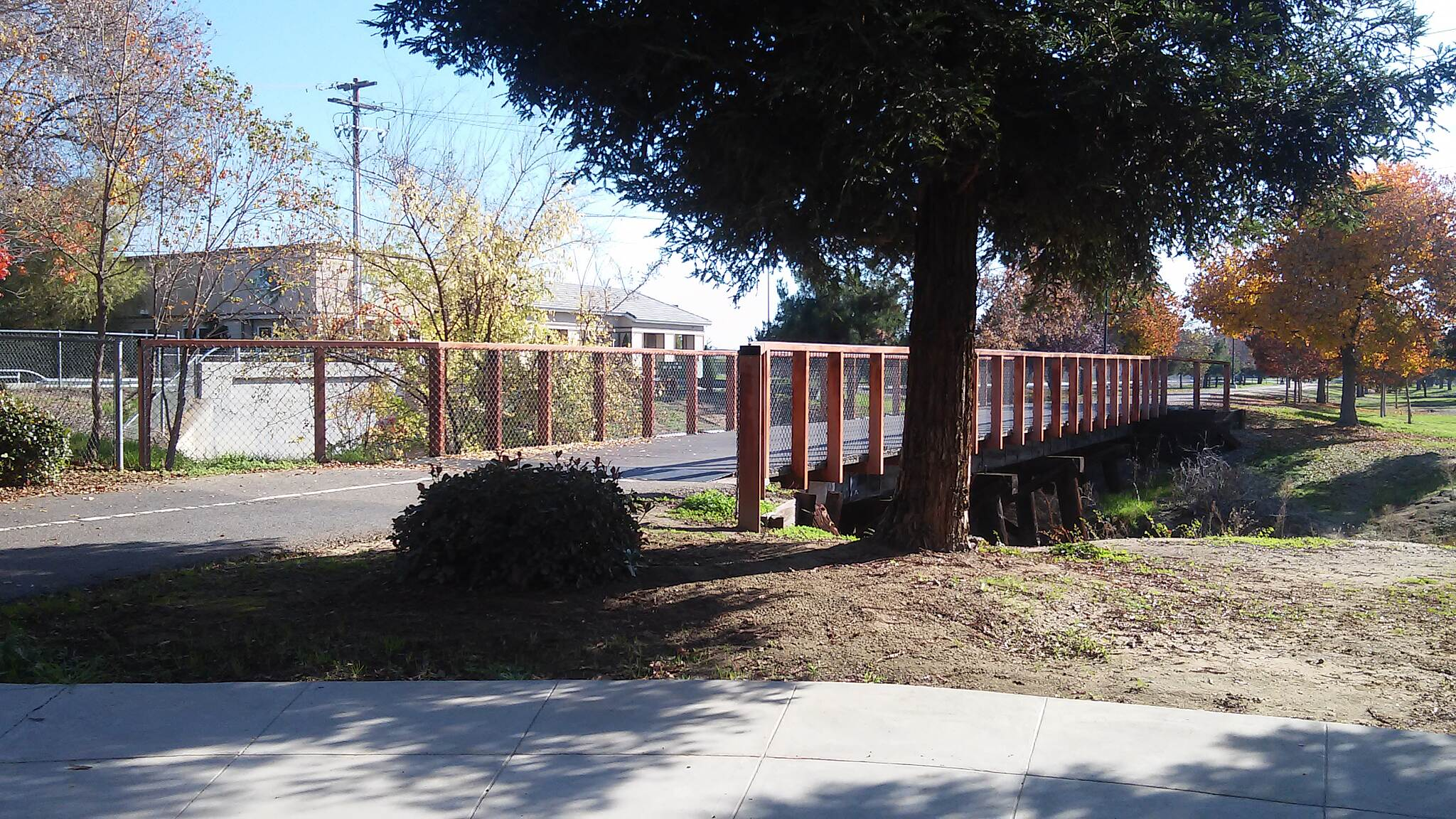 Clovis Old Town Trail at dry creek intersection little bridge on the old town trail branching off into the dry creek trail at the intersection