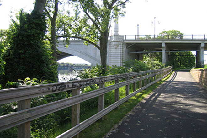 Connecticut Riverwalk and Bikeway Memorial Bridge with Trestle in Background Nice view looking north at Memorial Bridge with a view of the trestle through an arch.