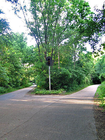 Constitution Trail North or East Looking North.  This railroad traffic signal stands where the Eastern branch (right) meets the Central North-South portion of the trail (left/behind).  Both bike routes are former railroad beds.