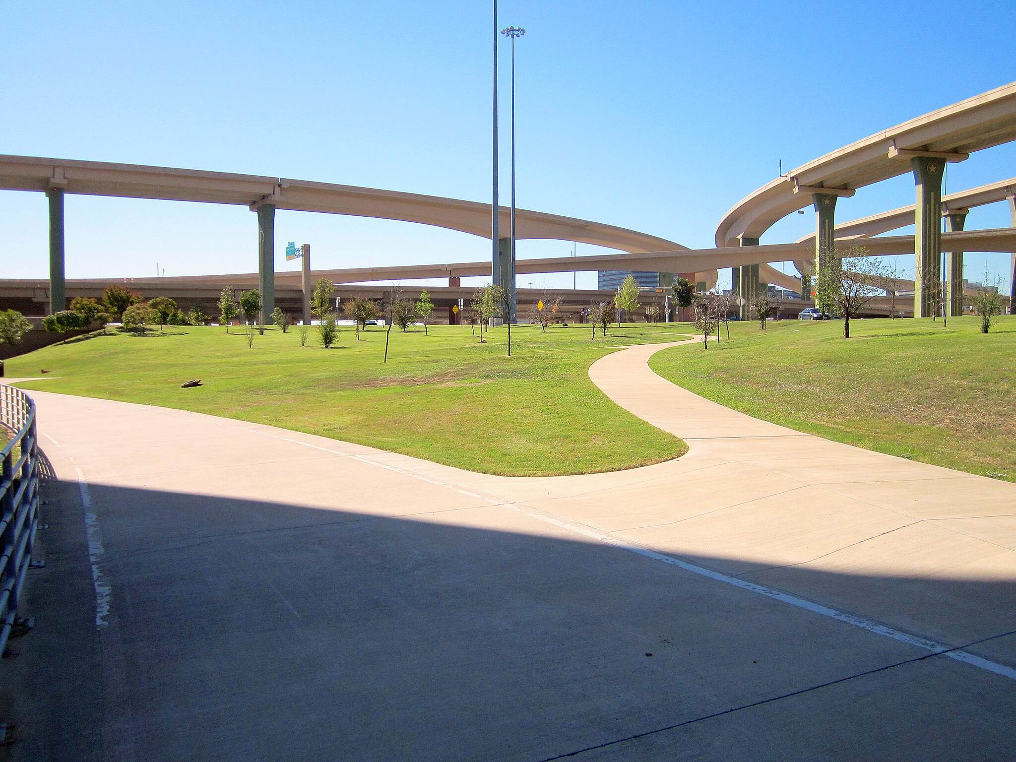 Cottonwood Trail The Dallas High-Five Interchange The interchange is considered by Popular Mechanics to be one of 'The World's 18 Strangest Roadways' because of its height (as high as a 12-story building), its 37 permanent bridges and other unusual design and construction features.