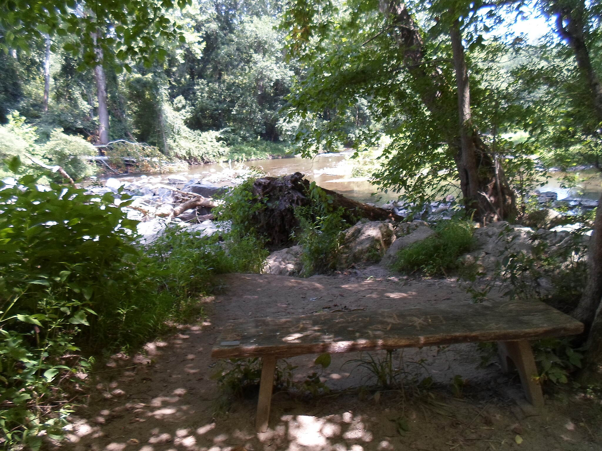 Creek Road Trail Creek Road Trail This wooden bench is a great place to relax and enjoy views of the White Clay Creek. Taken July 2015.