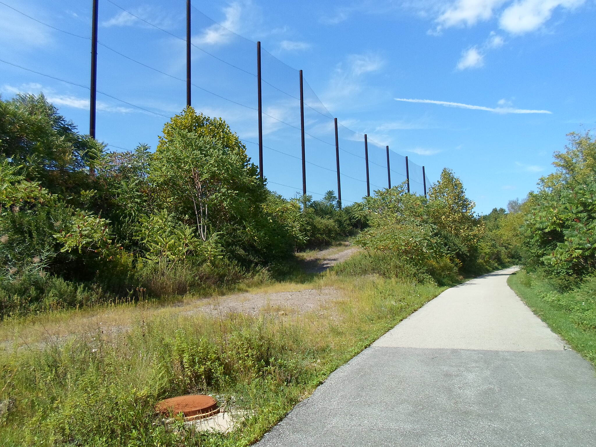 Cross County Trail (PA) Cross County Trail This high fencing northeast of Conshohocken protects the trail and its users from golf balls hit from a nearby driving range. Taken Sept. 2014.