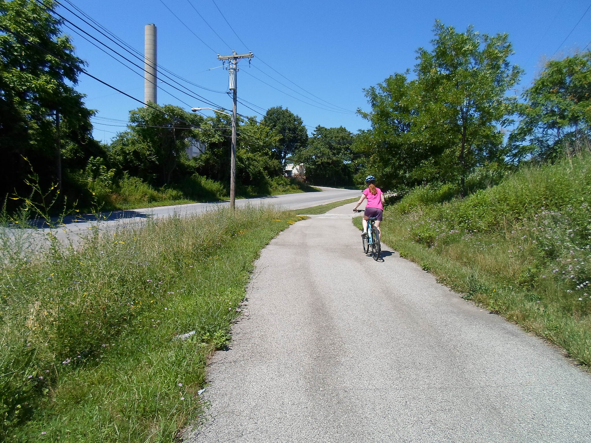 Cross County Trail (PA) Cross County Trail This woman was cycling up the trail near the poorly defined point where Allen Wood Road turns into Brook Road. Taken July 2014.