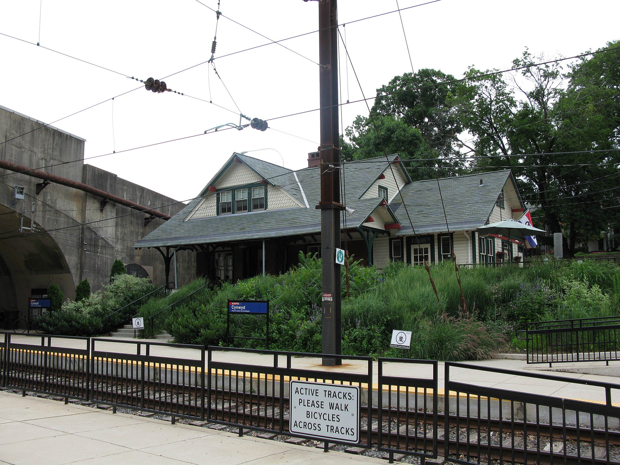 Cynwyd Heritage Trail Cynwyd Heritage Trail Cynwyd Station, seen across the tracks from the southern terminus of the trail. The station houses a cafe and ice cream shop, which is a welcome oasis in the summer heat. Taken June 2016.