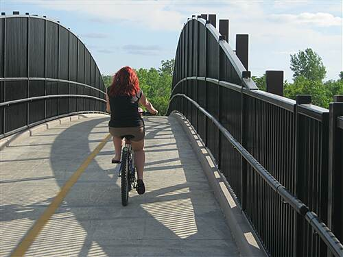 Dakota Rail Regional Trail   Rider crossing new bridge over Hwy 7.