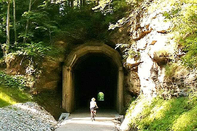 Dawkins Line Rail Trail Guncreek tunnel High ceilinged reinforced tunnel 660 feet long, 50 degrees inside while 92 degrees outside.