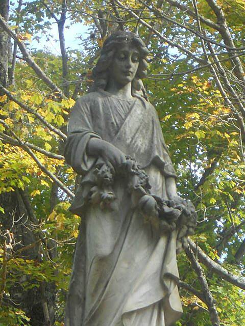Dawkins Line Rail Trail statue Family memorial Statue in the old cemetery. Most recent grave I saw was 1976.