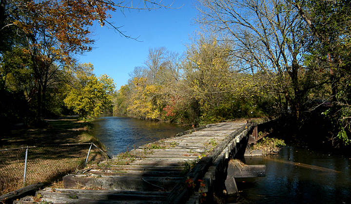 Delaware and Raritan Canal State Park Trail Old Railway Bridge over Canal This bridge crossed the canal with a rotating section to allow for barges in the transitional period between a canal and a railway economy. The Delaware river is off to the left out of the picture.
