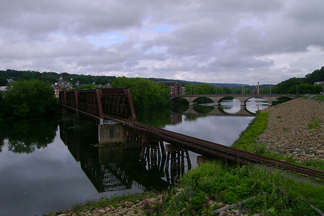 Derby Greenway View of railroad bridge and Derby-Shelton Bridge crossing the Housatonic River.