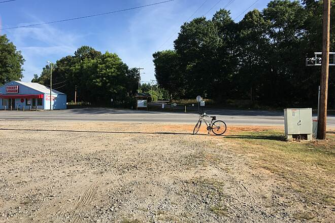 Doodle Rail Trail Fleetwood Drive Trailhead Trailhead (center of picture) at 514 Fleetwood Drive, Easley SC, has a map station.  There is a liquor store to left of trailhead, and gravel parking lot with port-a-potty to the right of trailhead.  June 2016