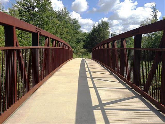 Douglas Trail Photo submitted by firebf881  This bridge is north of North Chester Ave and taken looking north across the bridge over Twenty Mile Creek and into the Right-of Way which likely will some day extend the train northward