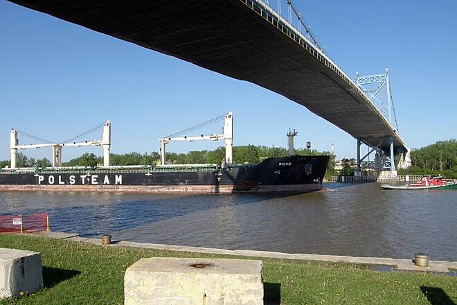 Dr. Richard D. Ruppert Rotary Trail International Park Lake freighter being towed out to lake Erie.Passing under the Anthony Wayne Bridge