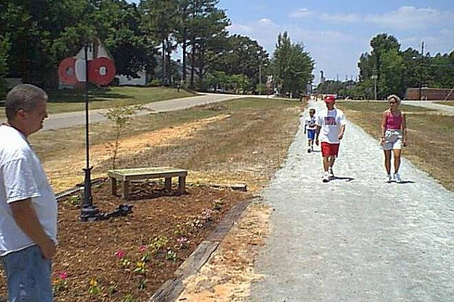 Dunn-Erwin Rail-Trail Come watch us grow! A friendly competition has germinated among neighbors in Dunn and Erwin to see who has the best trailside landscaping.