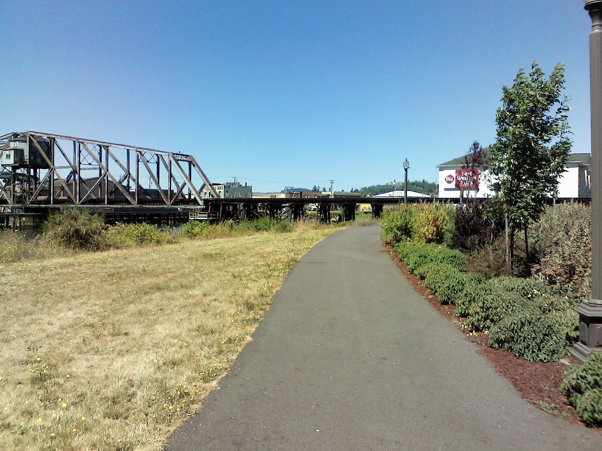 East Aberdeen Waterfront Walkway Trail's start by Walmart parking lot looking north Picturesque setting on a rare clear, warm and sunny July day in Aberdeen Washington. They get over 80 inches of rainfall a year here. Not today though!