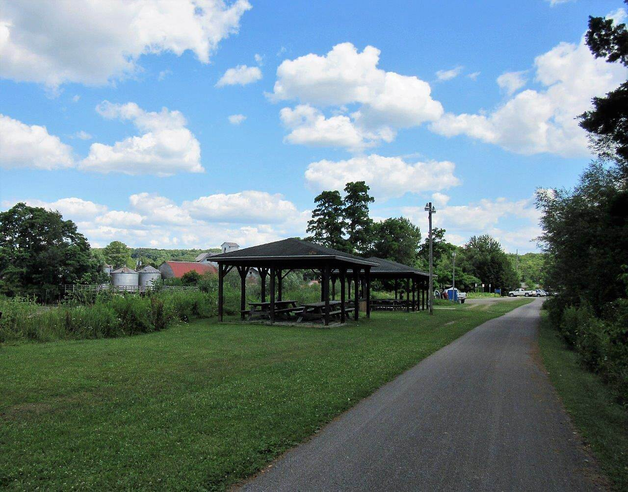 East Branch Trail (PA) Spartansburg Trailhead Picnic shelter with tables, parking lot and portable restroom.  July, 2017