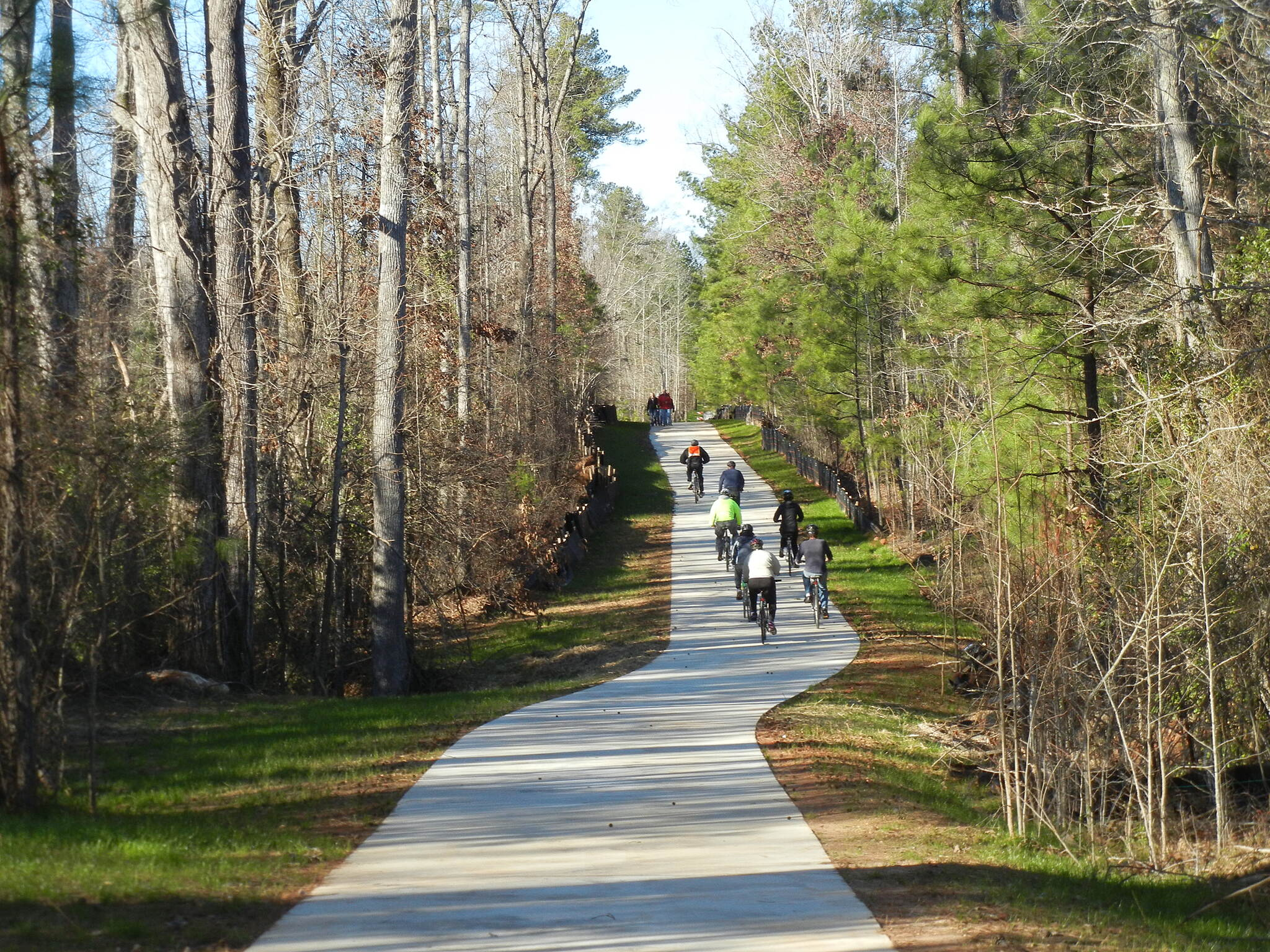 Eastside Trail (Covington) Rolling through the woodlands Leaving downtown Covington, walkers, joggers, and cyclists pass safely through a tunnel that avoids car traffic above and places them in another world -- with gentle rolling terrain through woodlands, wetlands, and hay fields.