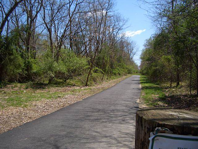 Edgar Felix Memorial Bikeway Freehold and Jamesburg Railroad Trail   I believe this is the same part of the path that is adjacent to the Pine Creek miniature railroad in Allaire State Park. looking east, April 2006