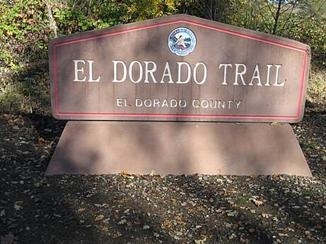 El Dorado Trail Trailhead sign Look for this sign on Jacquier Road, about 1/4 mile north of Smith Flat Road.  The sign isn't readily visible if you approach from the north.  There is a large parking lot near the sign.