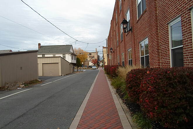 Elizabethtown Connector Trail Elizabethtown Connector Trail The brick ribbon pavement and trail lights on the side of the apartment building is a great demonstration of how greenways can enhance the communities they pass through. Taken Oct. 2015.