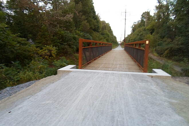 Enola Low Grade Trail Enola Low Grade Trail The newly opened trail bridge across Sigman Road in Providence Twp. eliminates one of the steep at-grade crossings that resulted from the removal of several RR bridges. It is also one of the first of many improvements scheduled for the trail.