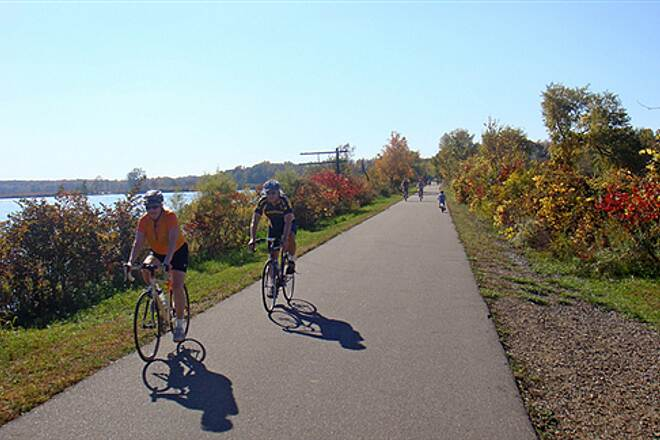Falling Waters Trail Falling Water Trail Cyclists enjoy a warm autumn day along the Falling Waters Trail where it crosses over Lime Lake via a 19th century causeway.