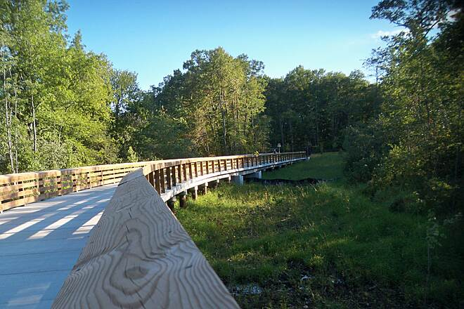 Farmington Canal Heritage Trail Last piece of Cheshire trail Smaller of the two curved, elevated structures to carry the trail over Willow Brook and nearby wetlands, between Cornwall Av. and West Main St.