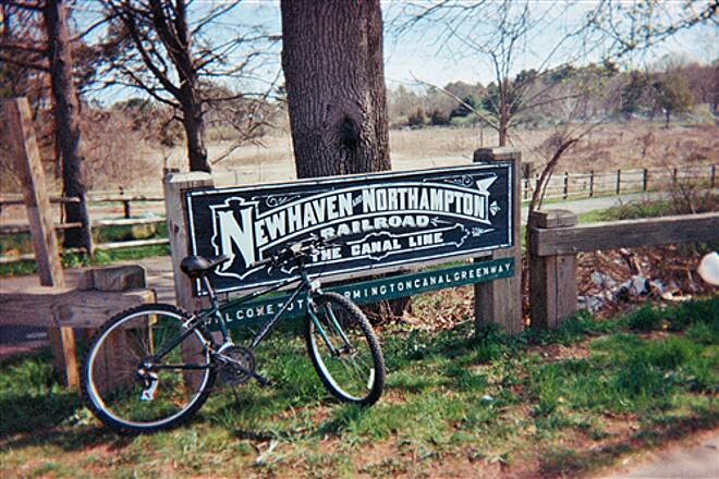 Farmington Canal Heritage Trail The railroad sign at a South Hamden trailhead My bike next to a restored railroad sign for the 'canal line.' This is at Skiff St, I think, although I'm not certain.