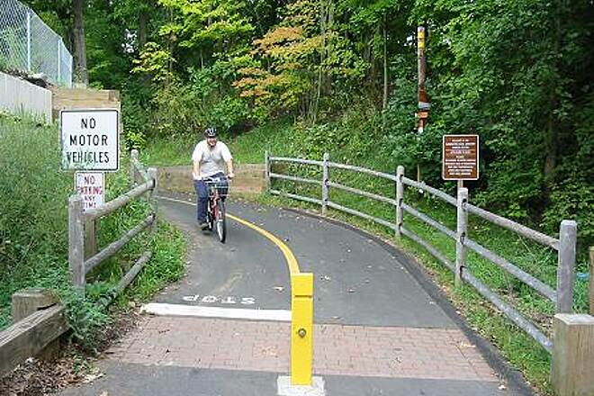 Farmington Canal Heritage Trail Farmington Canal Greenway A bicyclist exiting the trail at Dixwell Avenue in Hamden.