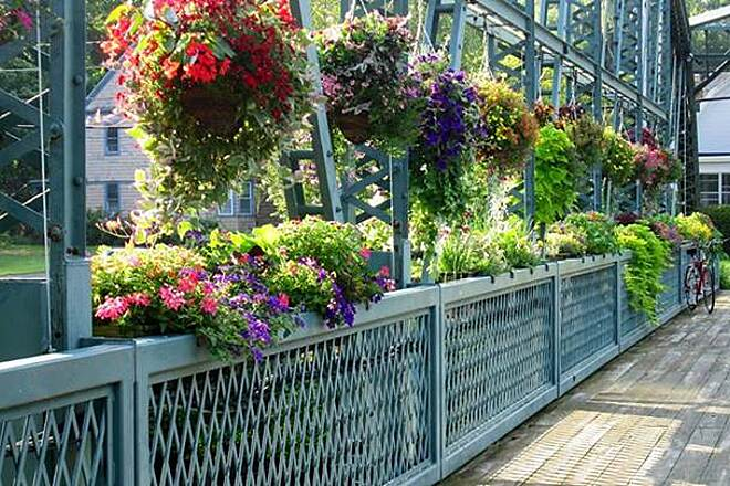Farmington Canal Heritage Trail Old Drake Hill Flower Bridge This picture was taken by my sister Beth who rides this trail frequently as she lives less then a mile from it. The Old Drake Hill Flower Bridge is in Simbsbury, CT, and one of her favorite spots to take a break on her ride as it is right off the trail.