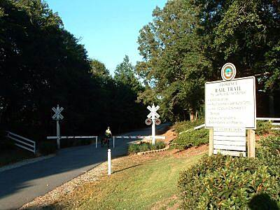 Florence Rail Trail (SC) Rail Trail Western entrance This is the beginning of the trail at the Ebenezer Road parking area. It is flat and paved for two miles.