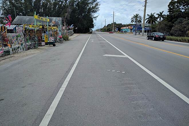 Florida Keys Overseas Heritage Trail Well thought out bike lanes in Islamorada They cut out grooves in the road to alert drivers they are swerving off the road.