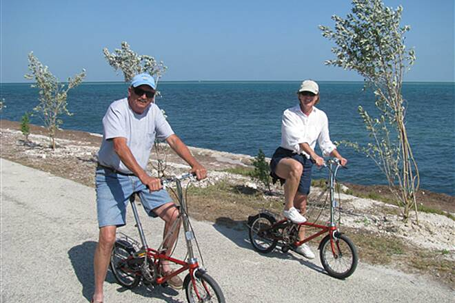 Florida Keys Overseas Heritage Trail bicyclists at Knight's Key section of FKOHT folding bikes ride past Earth Day tree planting April 2008