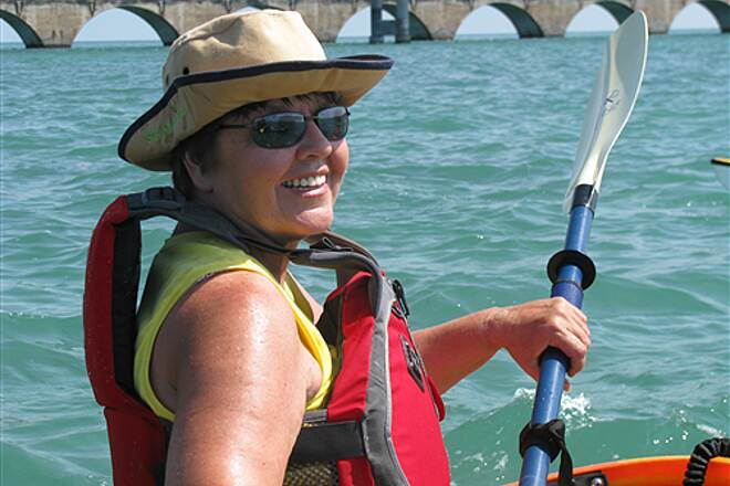 Florida Keys Overseas Heritage Trail paddling to Molasses Key in Marathon Jo Ann Robinson with Seven Mile bridge in background