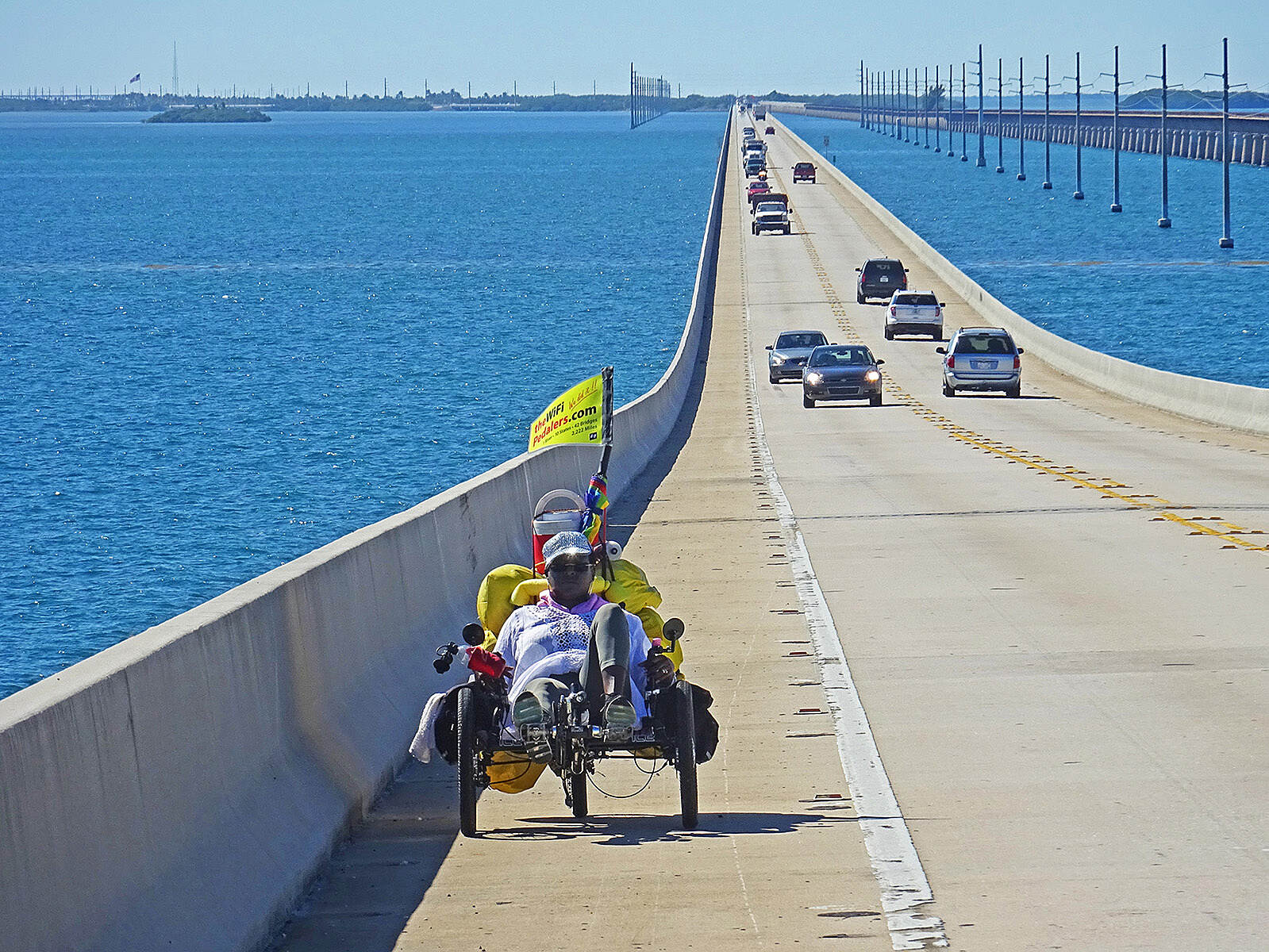 Florida Keys Overseas Heritage Trail WiFi Pedalers on 7-mile Bridge We may be the first recumbents to cycle the entire Keys, starting at Key West, and continuing through Key Largo on our way to Miami, Palm Beach, Melbourne, and Orlando. Here Earline climbs the 'hump' of the 7-mile bridge. See blog.thewifipedalers.com.