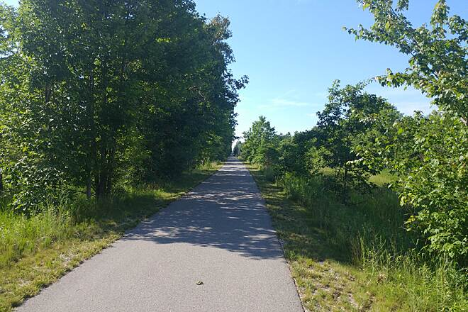 Fred Meijer Berry Junction Trail The trail between W Riley Thompson Rd and Michillinda Rd Taken on June 19, 2016