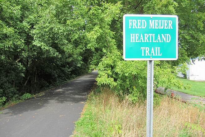 Fred Meijer Heartland Trail Trail sign at Jackson's Landing This is where the trail begins at Jackson's Landing.  The Flat River Trail is 20 feet away.