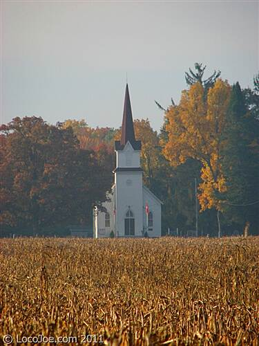 Fred Meijer Heartland Trail Church Church viewed across field from trail. October 2011