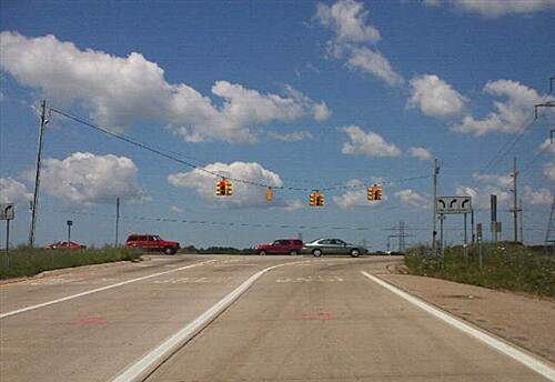 Fred Meijer M-6 Trail M-6 westbound exit Two exit lanes cross the trail with no warning to drivers