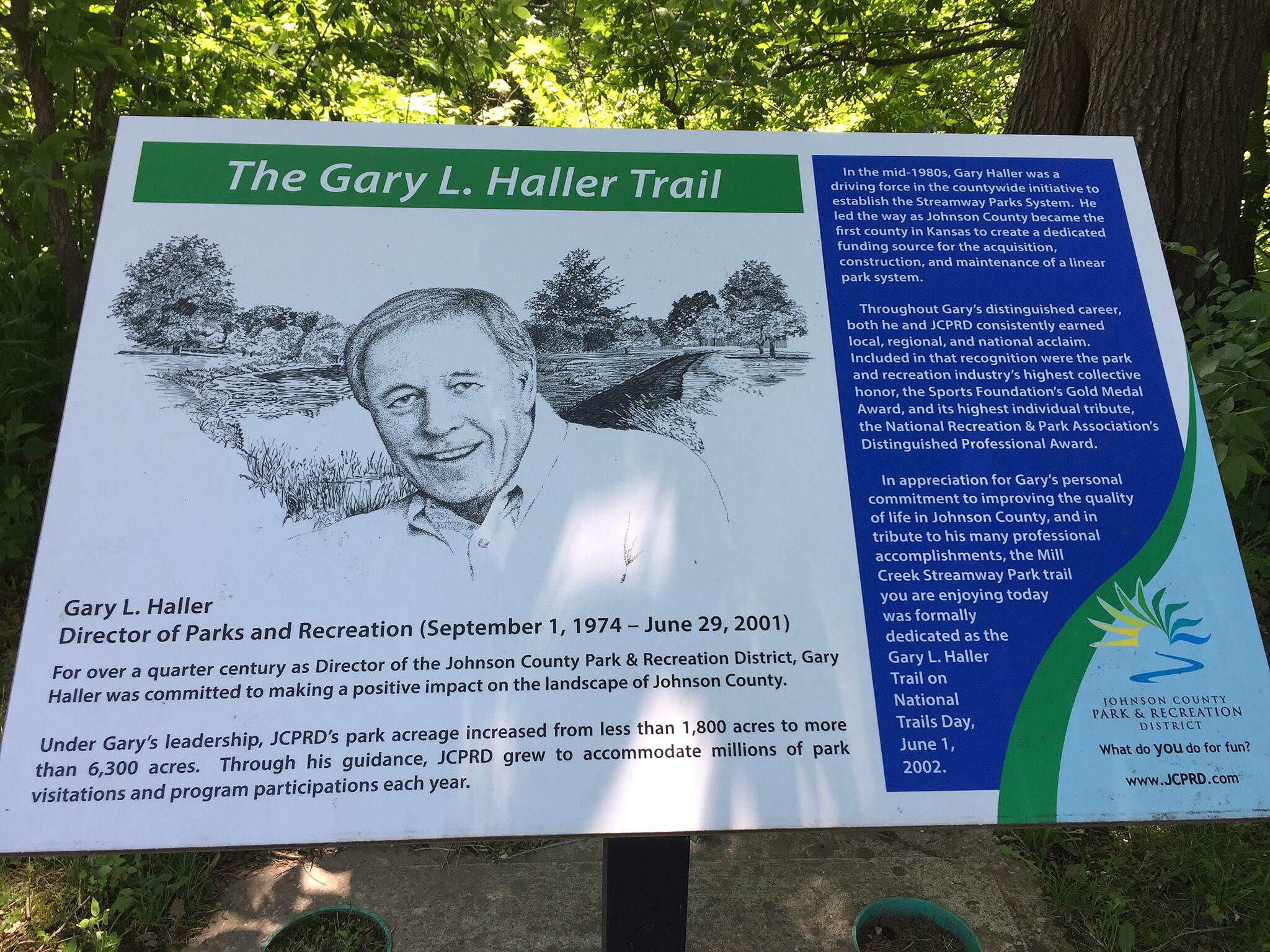 Gary L. Haller Trail Trail sign Detailing the work of Gary Haller