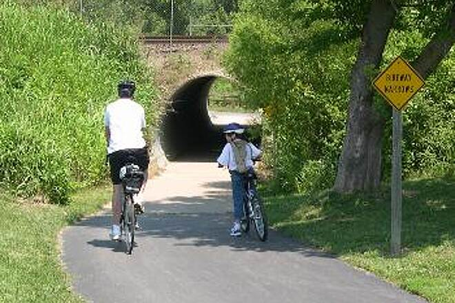 Gary L. Haller Trail Tunnel Under the Railroad One of two tunnels that cut through the elevated railbed of a very active railroad. These tunnels give through access to Craig Crossing Park and to the 87th Lane Access trailhead.