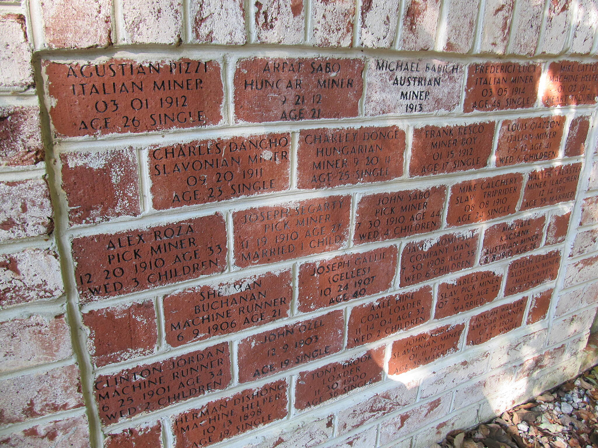 Ghost Town Trail Ghost Town Trl miners exhibit The bricks had names of miners that had died.  The exhibit was near Vintondale