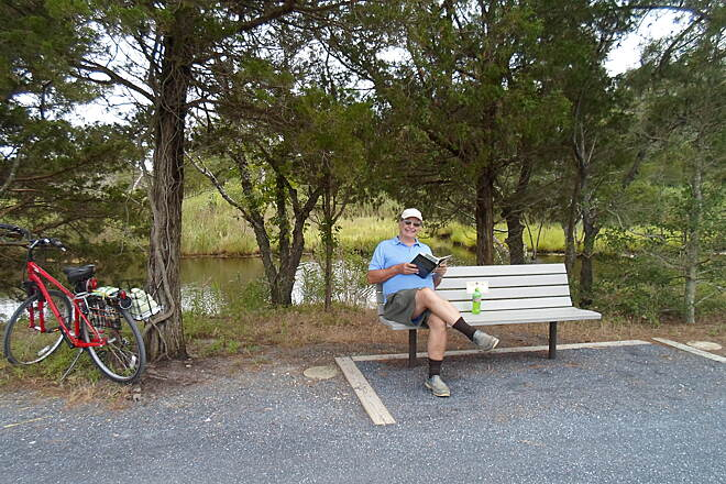 Gordons Pond Trail Gordons Pond Trail This cyclist was relaxing and enjoying a good book on a warm, midsummer day. Taken July 2015.