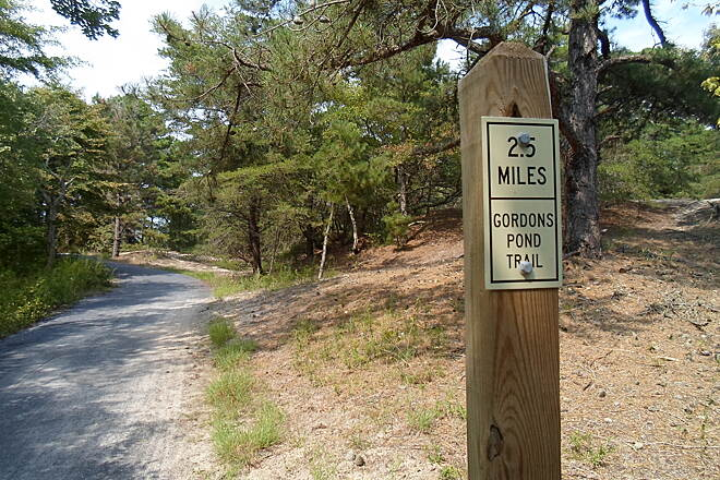 Gordons Pond Trail Gordons Pond Trail Sign near Herring Point, marking the distance to Whiskey Beach. Taken July 2015.
