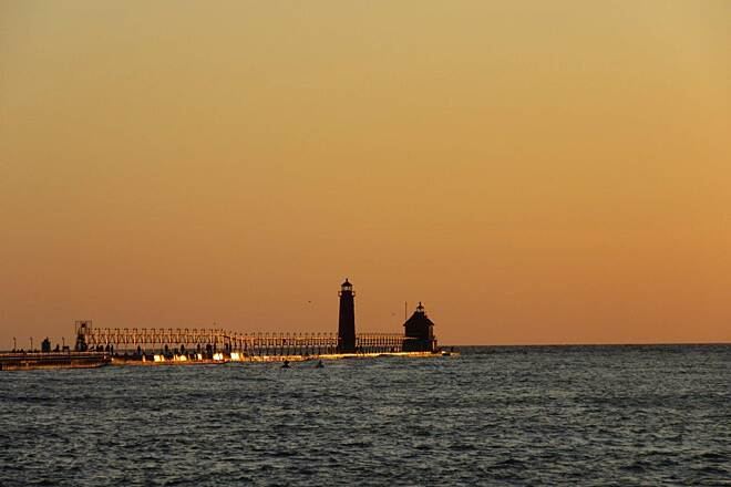 Grand Haven Waterfront Trail Lighthouse Sun setting on the Grand Haven Lighthouse
