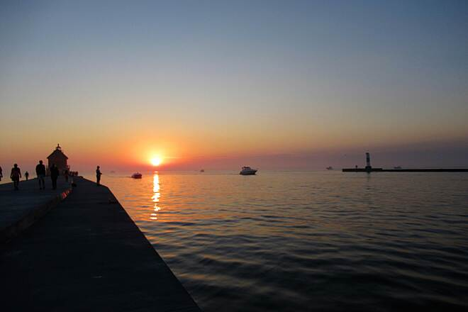 Grand Haven Waterfront Trail Sunset over Lake Michigan You can bike up to the end of the pier to see the sunset