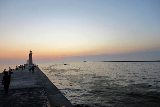 Grand Haven Waterfront Trail Sunset over Lake Michigan Grand Haven lighthouse pier/catwalk.  You can bike to the sunset.