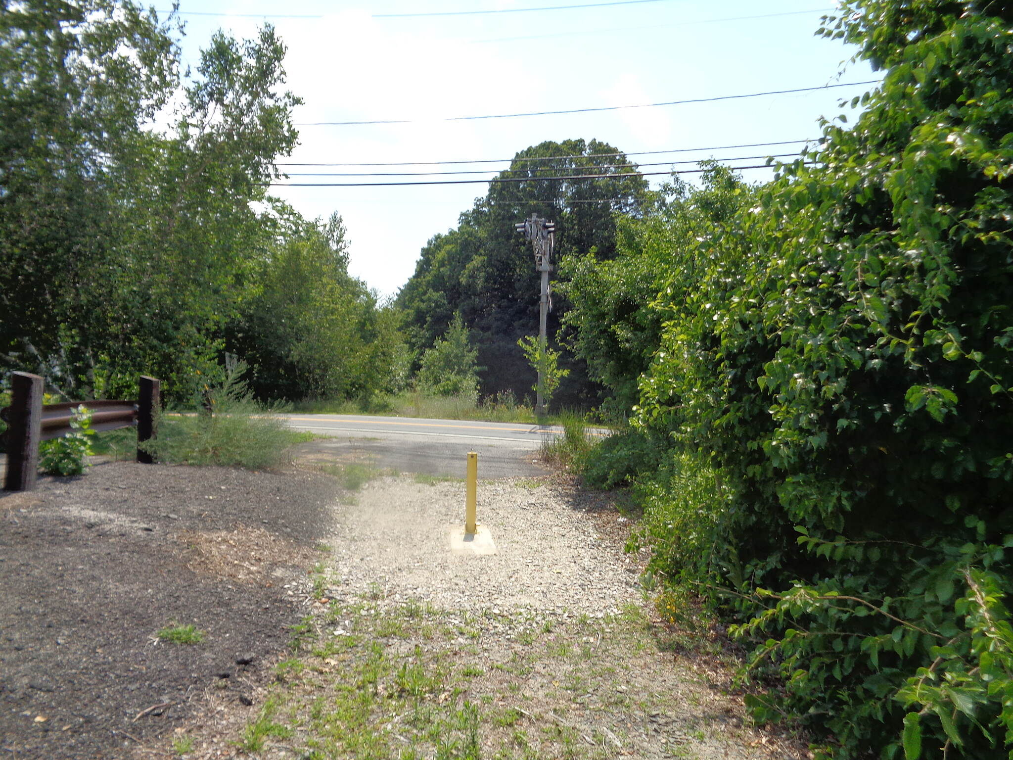 Grand Trunk Trail Route 12 crossing Looking west across Route 12 in Dudley 7/17/16. Trail is cleared on this side but overgrown across the highway.