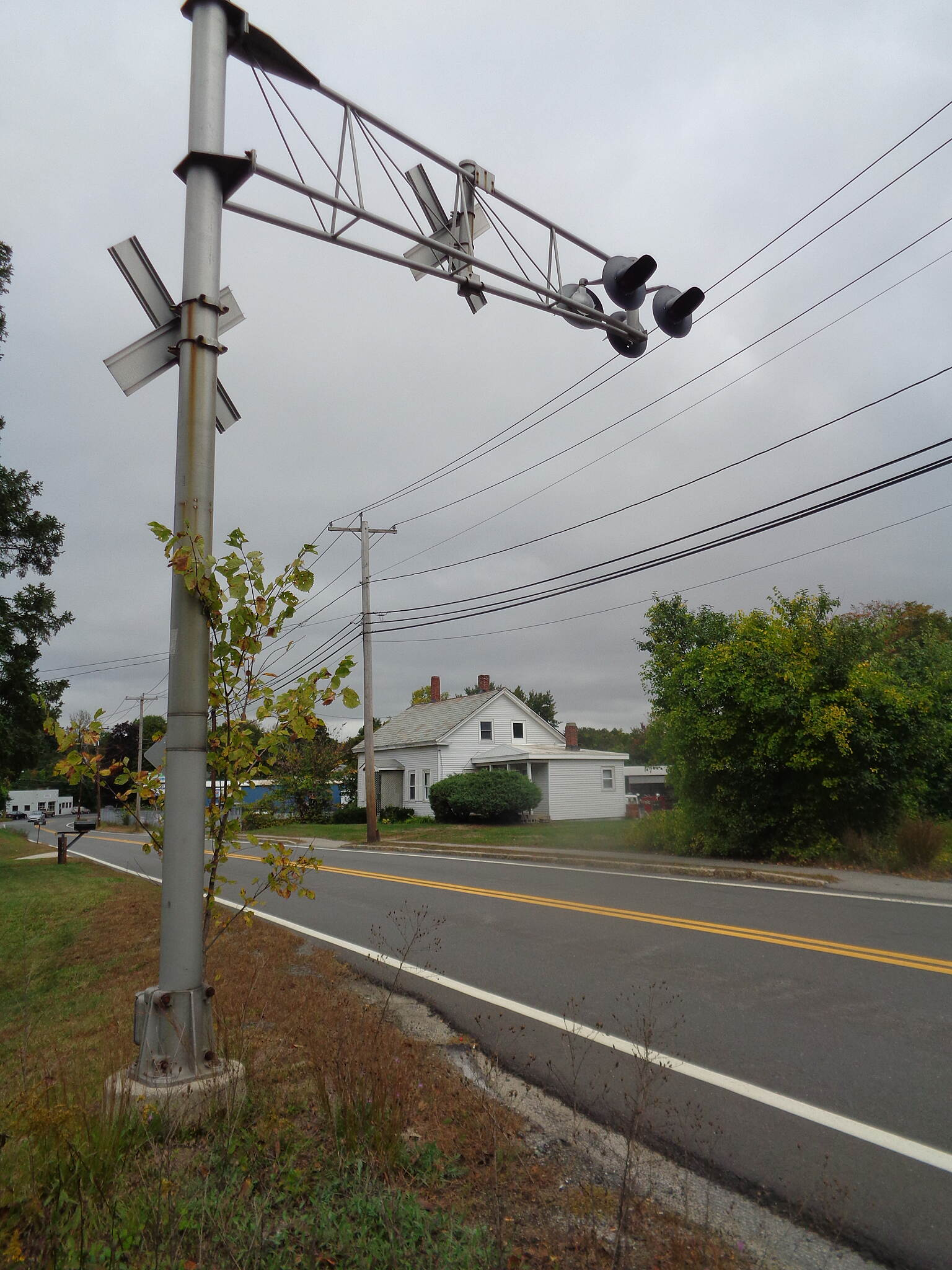 Grand Trunk Trail Crossing signals at Rte 12 These crossing signals remain at Route 12 Dudley, viewed looking eastward on 9/28/16. It is proposed to relocate to the small railroad museum in neighboring Webster.